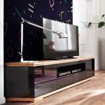 Design Fernsehunterschrank in Schwarz Hochglanz Asteiche Massivholz